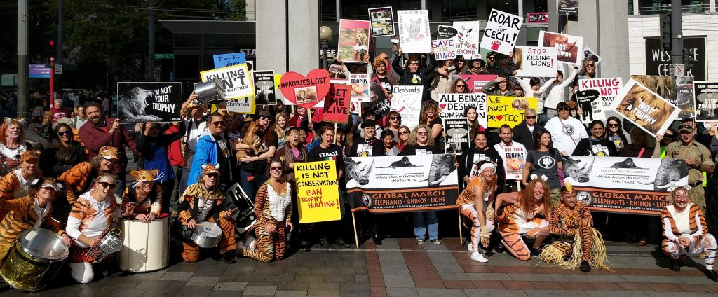 Marchers for Rhinos and Elephants, posing at Westlake Center.