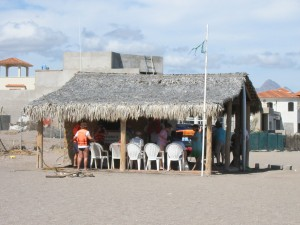 The local office of Arturo's Sport Fishing. This picture shows passengers from a visiting cruise ship assembling for a tour.